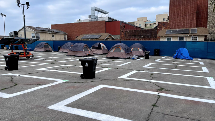 A parking lot has been turned into a homeless encampment that offers 24-hour security and free meals.