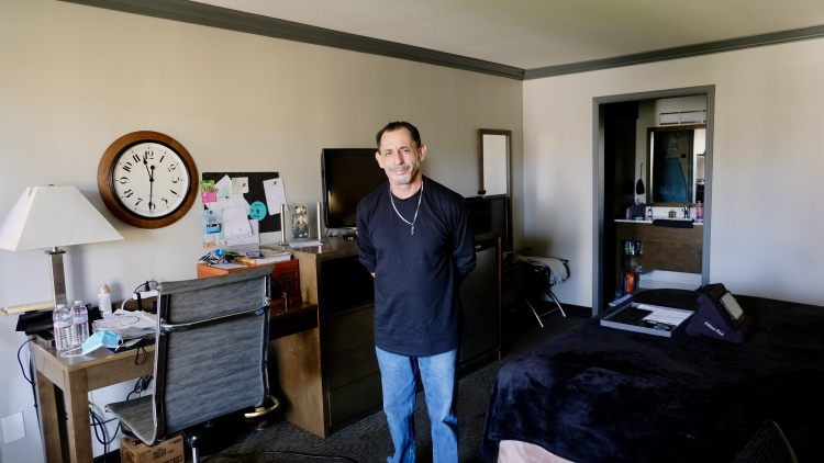 KCRW profiles a resident of Homekey, a statewide program to turn hotels and motels into homeless housing. But how do you build stability in a place designed for temporary stays?