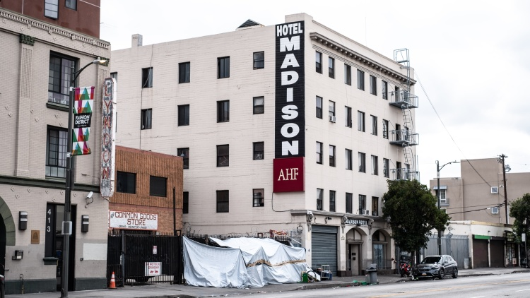 As some hotel rooms sit empty, tens of thousands of people live on the streets of Los Angeles.