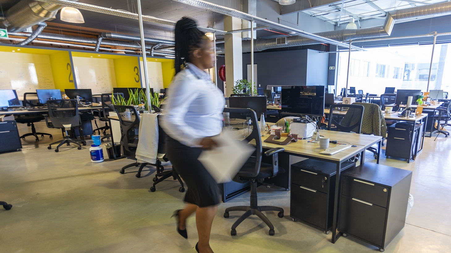 When returning to the office, employees can expect to still wear masks, physical distancing, new desk arrangements, and one-way hallways or stairways, according to pandemic planner Regina Phelps.