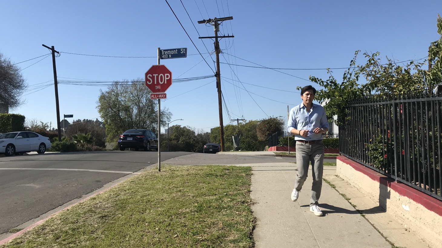 Kevin de Leon (pictured) walks door to door in Ramona Gardens asking for voters' support in the upcoming California primary election, where he is running for LA City Council.