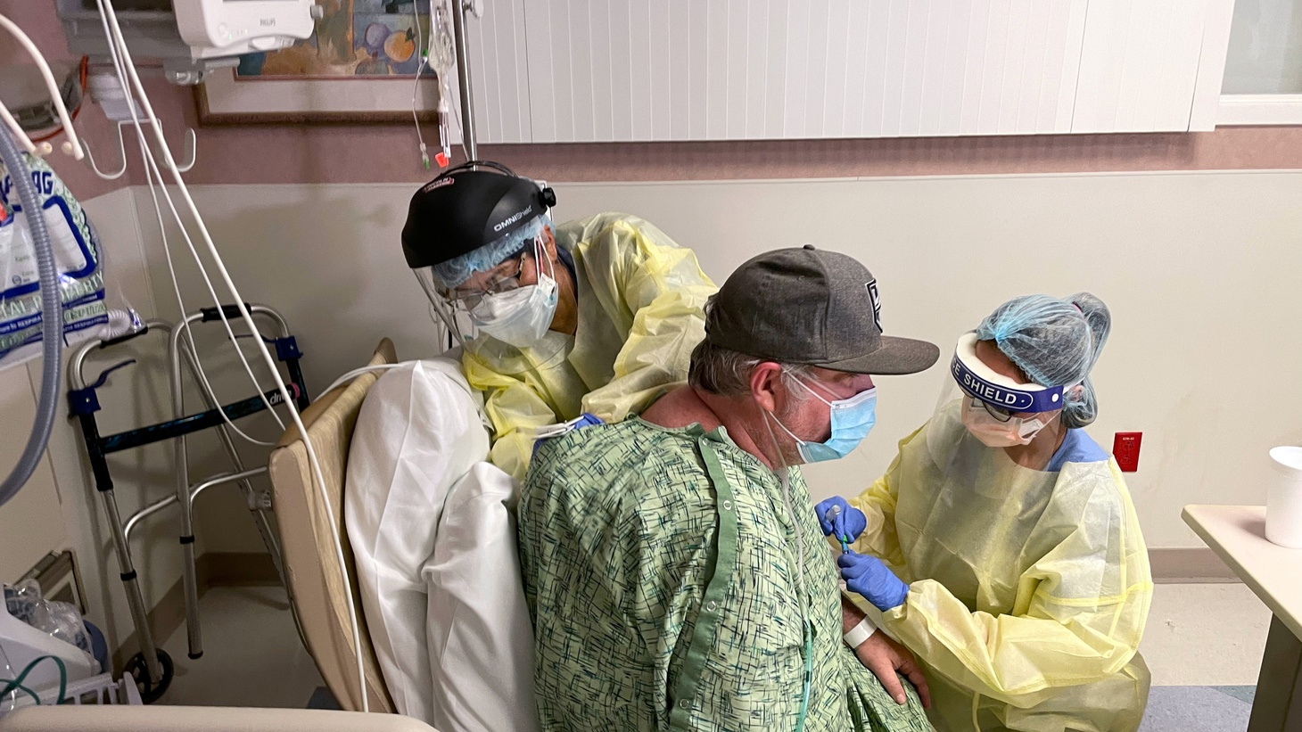 COVID-19 patient Brian Parisi, 53, from Orange County, is treated by staff in the ICU at Providence St. Joseph Hospital in Orange, California, U.S. July 23, 2021.