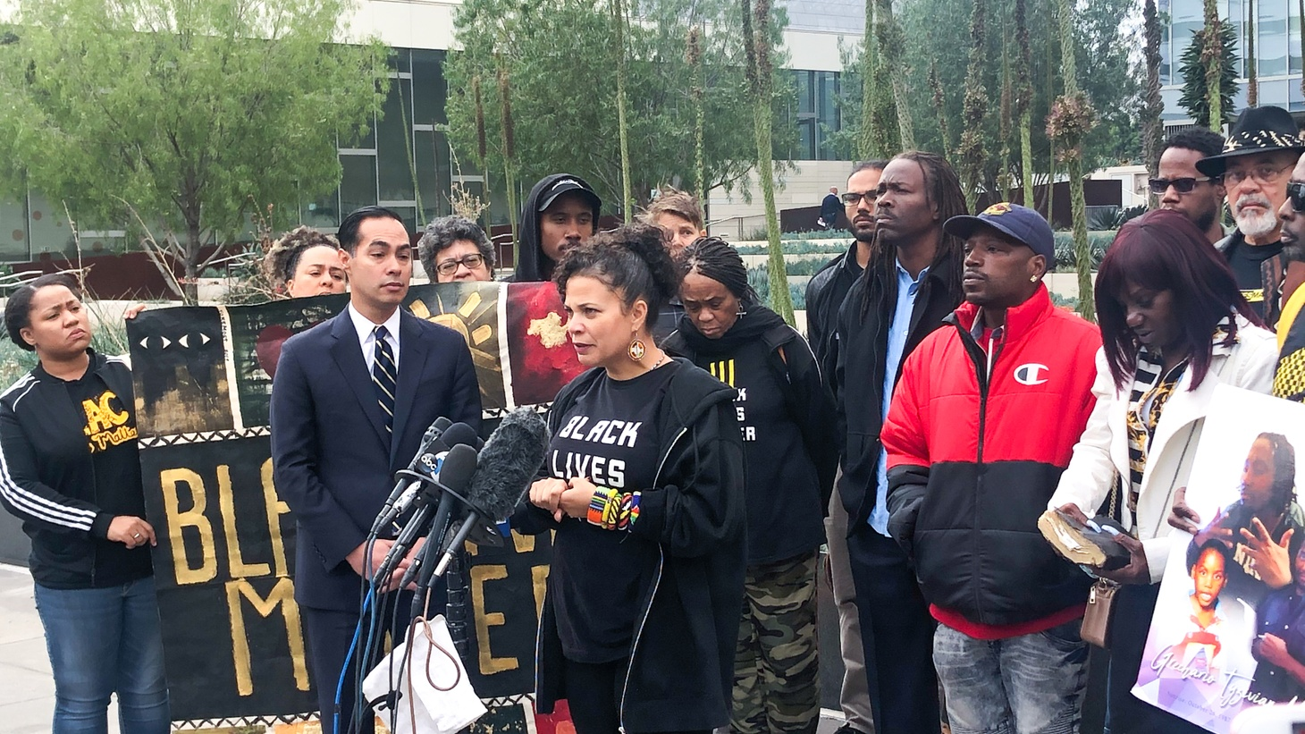 Democractic presidential hopeful Julian Castro joins Black Lives Matter co-founder Melina Abdullah and others in calling for two LAPD officers to be fired in the police shooting of Grechario Mack, 30.
