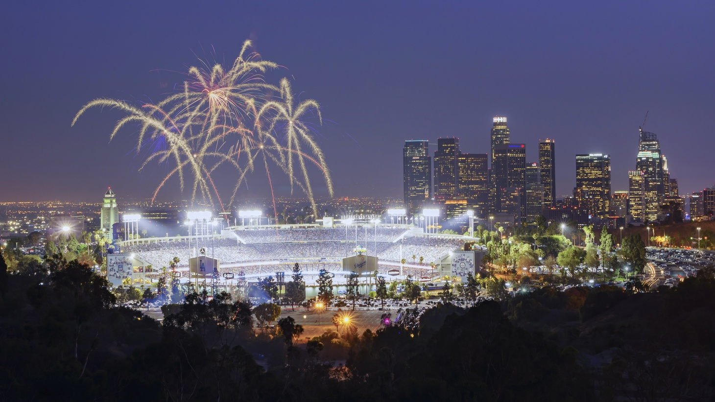 Fireworks light up over Dodger Stadium. Fireworks are illegal in the City of LA, but the LA Fire Department has a list of professional shows on their website that you can attend through the July 4 weekend.