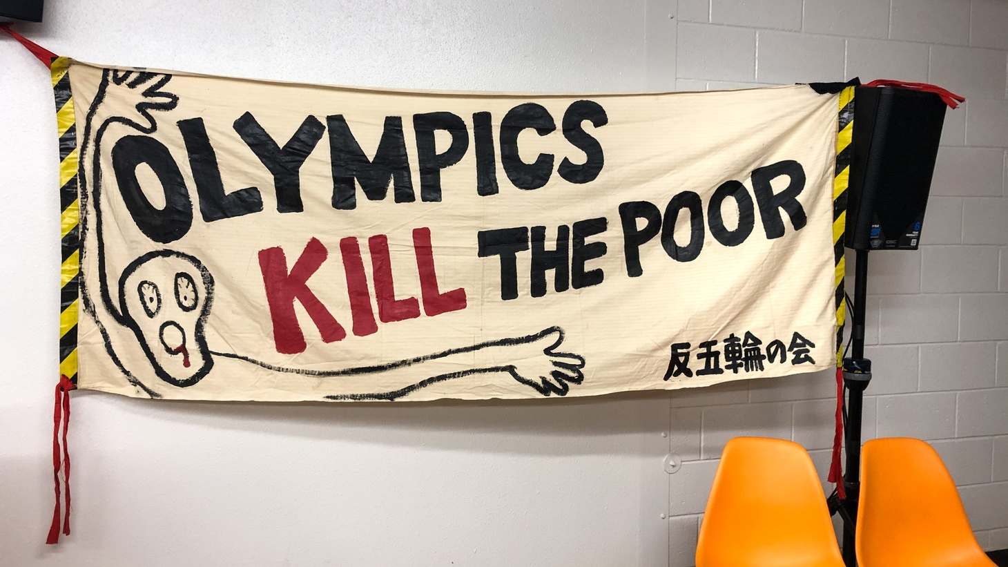 """A poster saying """"Olympics kill the poor."""""""