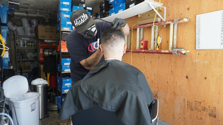 Hair salons have reopened in LA County, but when the COVID-19 pandemic kept them closed for more than two months, one South LA barber was cutting hair illicitly out of his garage.