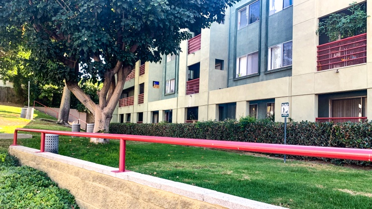 In an unusual last-minute deal, tenants at a Chinatown apartment building called Hillside Villa will be able to continue paying below market rents for another 10 years.