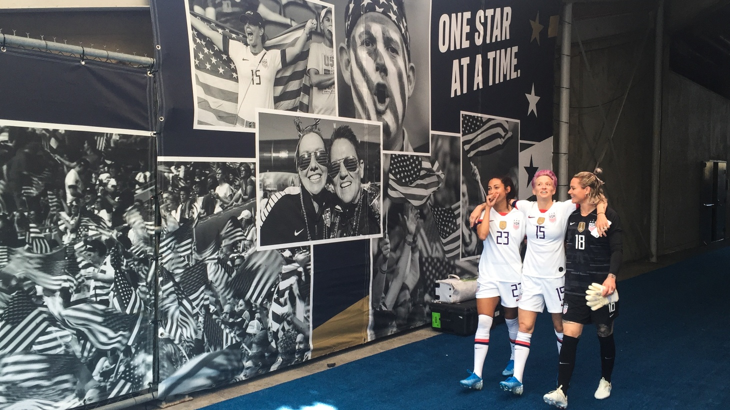 Christen Press, Megan Rapinoe, and Ashlyn Harris walk out to the field at the Rose Bowl on August 3, 2019.