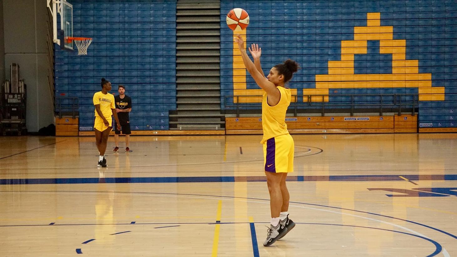 An LA Sparks team member making a shot