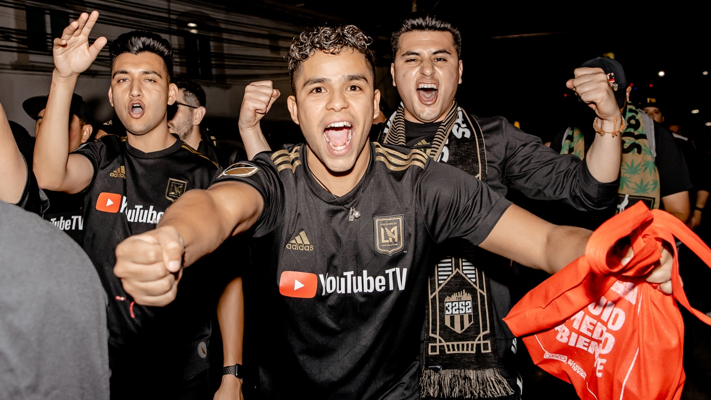 Los Angeles Football Club supporters sing and chant as they march to Estadio León for LAFC's first ever CONCACAF Champions League match.