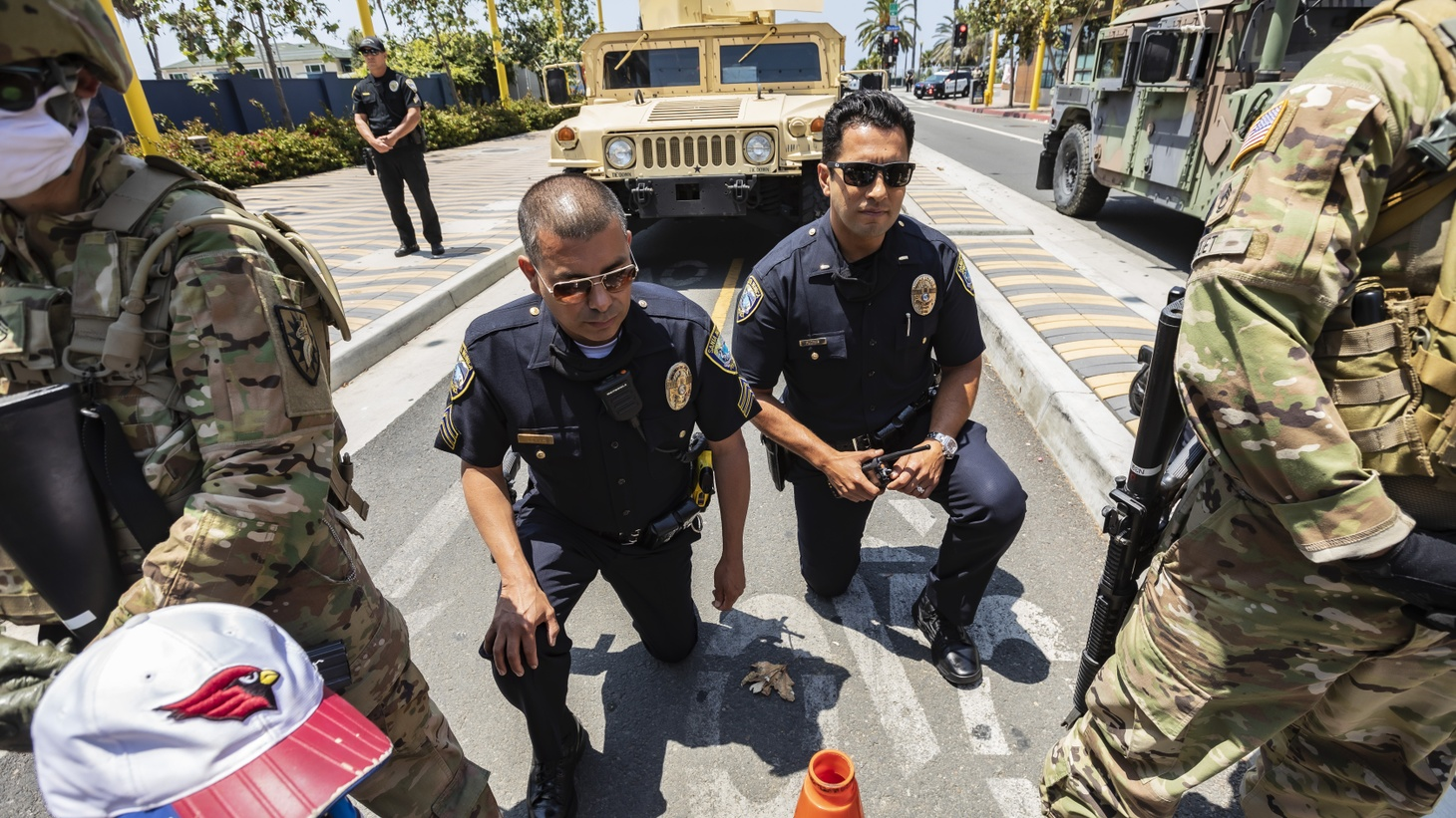 Santa Monica police officers Sgt. Leyva and Lt. Flores take a knee during a moment of silence for George Floyd, during a protest against racial injustice. June 4, 2020, Santa Monica, CA.