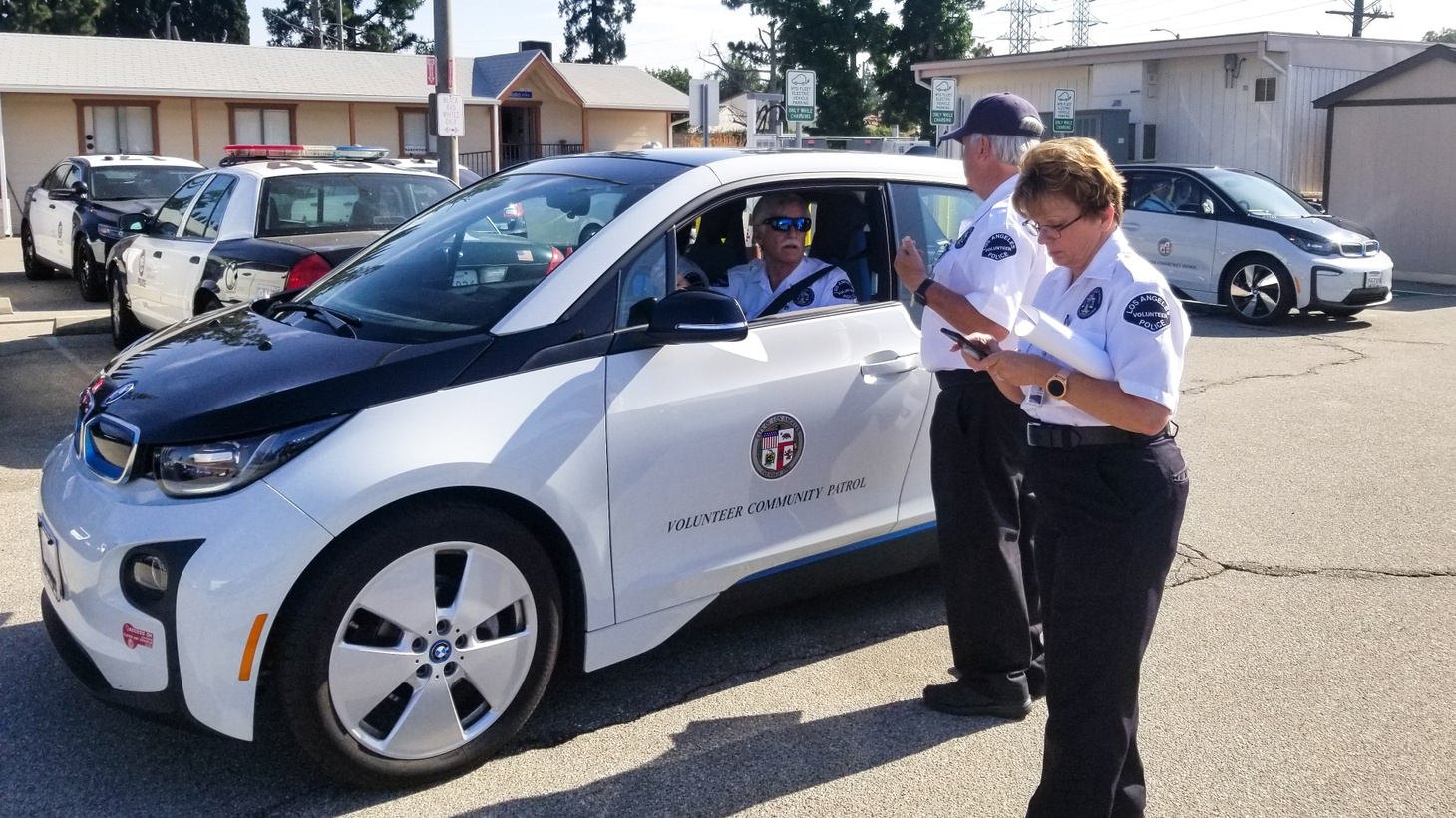 Terri Perez (right), Bill Cotter (center) and Richard Fisk (left), volunteers with the LAPD's Devonshire Division.