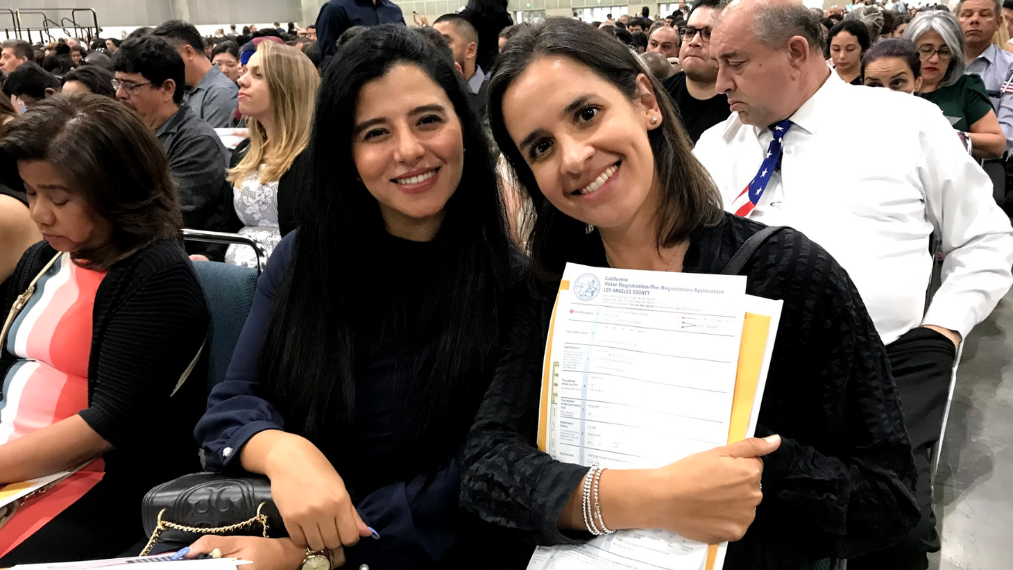 Sandra Abdel-Mesih (left) and Jenny Mora shortly before taking the Naturalization Oath of Allegiance to the United States of America during a ceremony at the LA Convention Center.