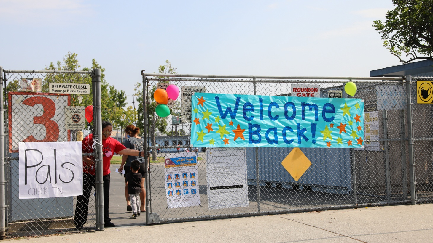 """A """"welcome back"""" banner is seen at Montara Avenue Elementary School in South Gate, August 16, 2021. Photo by Zaydee Sanchez for KCRW."""