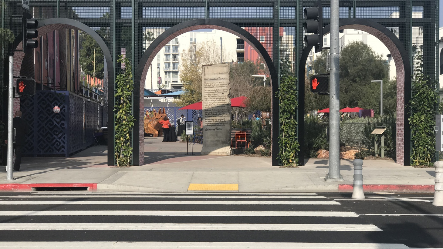 A gateway off N. Main Street marks the entrance to the paseo, which was designed by LA-based landscape designers SWA, and continues through the LA Plaza Village mixed-used development.