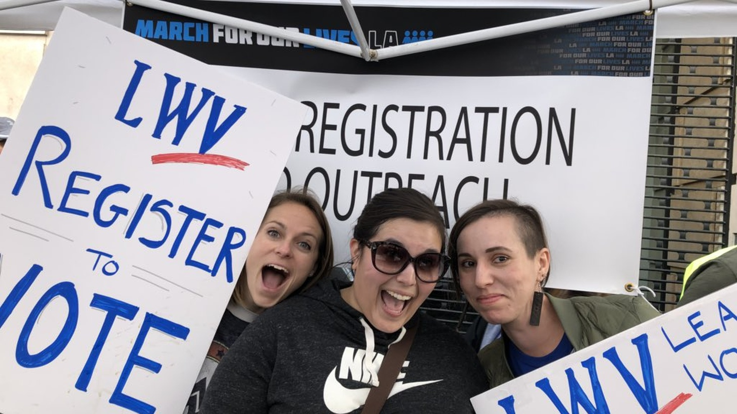 Lex Roman (right) at a registration outreach table.