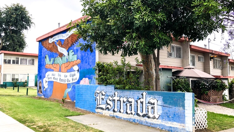 Estrada Courts, a public housing project in East Los Angeles, is a series of aging, two-story buildings arranged around common outdoor areas.