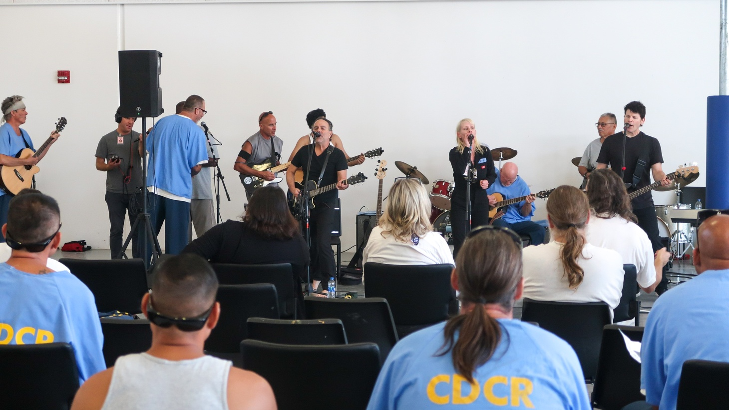 Cody Marks and her band performing at Richard J. Donovan prison.