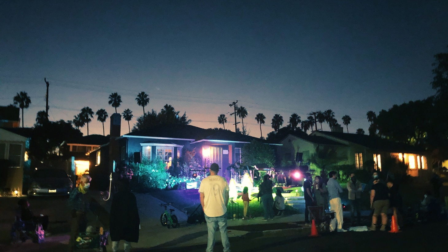 Raquel Rodriquez performs music on her front yard for neighbors and friends.