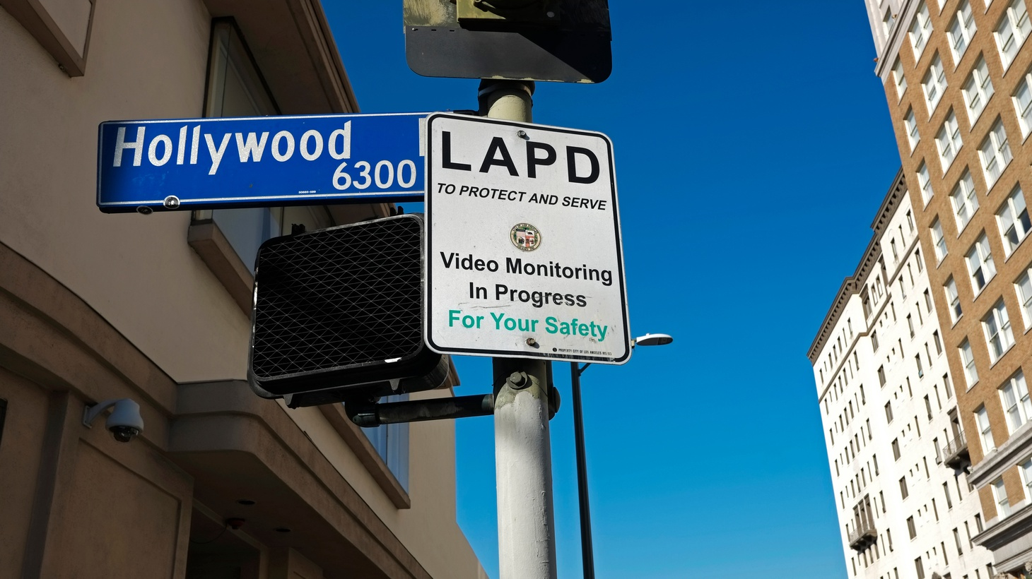 An LAPD sign on Hollywood Boulevard says video monitoring is in progress.