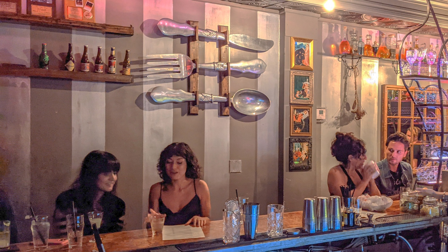 Without masks or social distancing, people enjoy drinks at Risky Business, a private bar in North Hollywood.