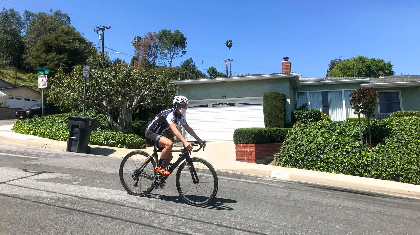 Some cyclists are now wearing masks when riding outside. You can probably be socially distant while exercising outdoors. But Paula Cannon, professor at the Keck School of Medicine at USC, says a mask signals that you care about your neighbors just as much as yourself.