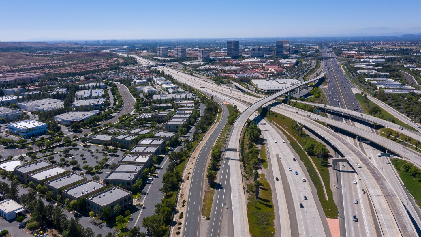 A daytime aerial view shows the 405 and 5 freeway interchange in Irvine, California. Orange County has a $200 million plan to build toll lanes on its section of the 405 freeway.