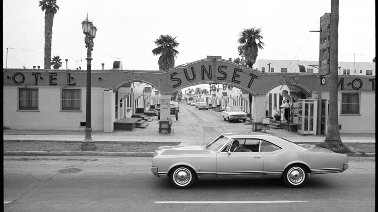 Artist Ed Ruscha took 12 road trips down Sunset Boulevard from 1965 to 2007, photographing tumultuous moments there, daily life, and quintessential street scenes.
