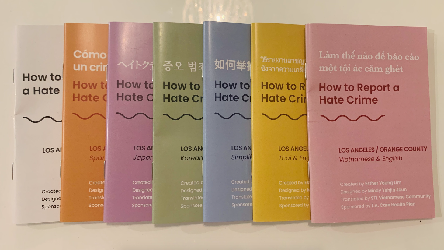 """""""How to Report a Hate Crime"""" booklets come in Vietnamese, Thai, Korean, Chinese, Japanese, Spanish, and English. Here are the new cover designs."""