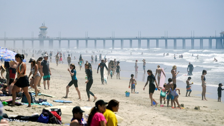 Unlike LA County, some of Orange County's shores were open to beachgoers over the weekend.