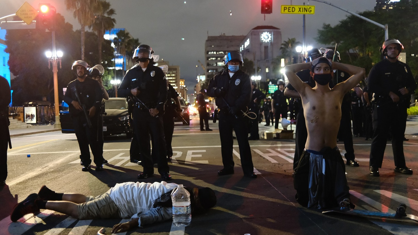 LAPD officers boxed in demonstrators who laid on the street in protest.