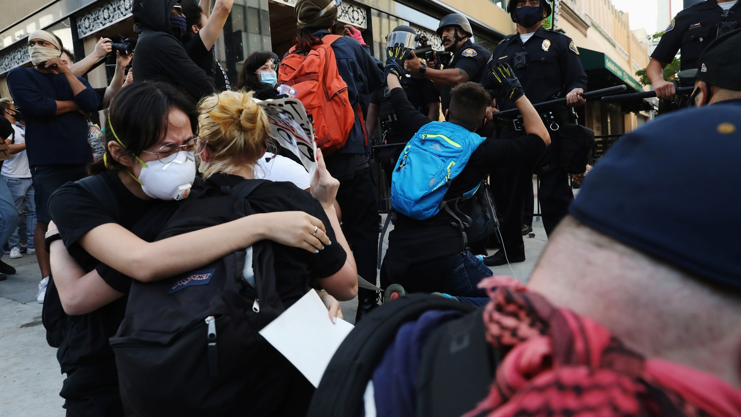 Demonstrators react as they protest amid nationwide unrest over the death in Minneapolis police custody of George Floyd, in Long Beach California, U.S., May 31, 2020.