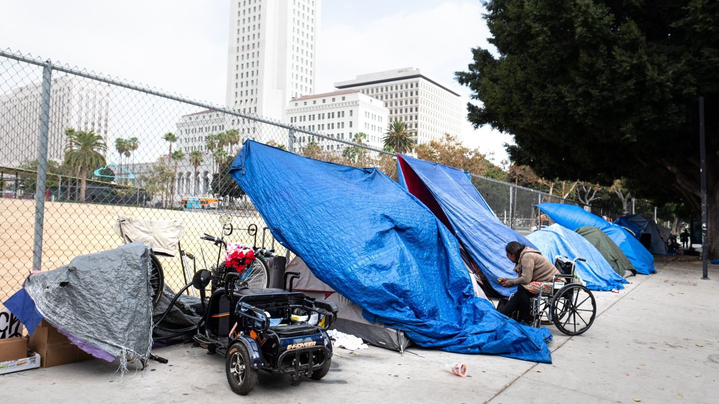 Homeless encampments are seen near LA City Hall. On March 2, 2021, LA City Council voted to approve a detailed plan allocating $88.8 million of LAPD's budget toward homeless prevention and services, policing alternatives, and council districts experiencing the highest rates of poverty and unemployment.