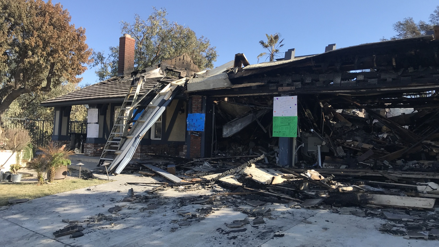 The Saddleridge fire destroyed dozens of buildings, including some homes, like this one on Hampton Court in Porter Ranch