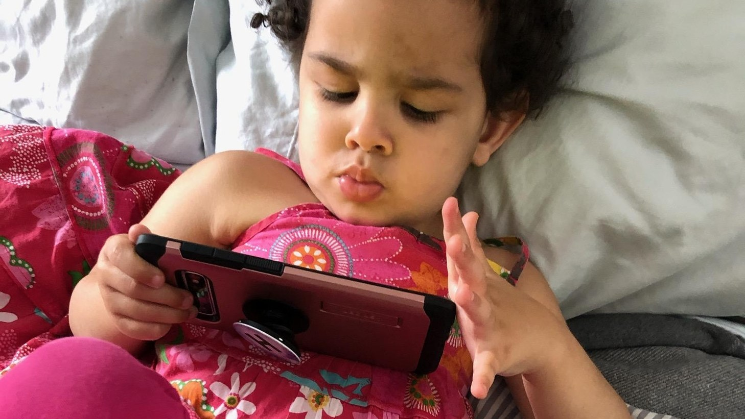 """Three-year-old Alice Aurelia Grant loves watching """"Frozen"""" and """"Frozen II."""" Prior to stay-at-home orders, she never was allowed screen time. Now, it's the de facto babysitter while her parents work from home."""