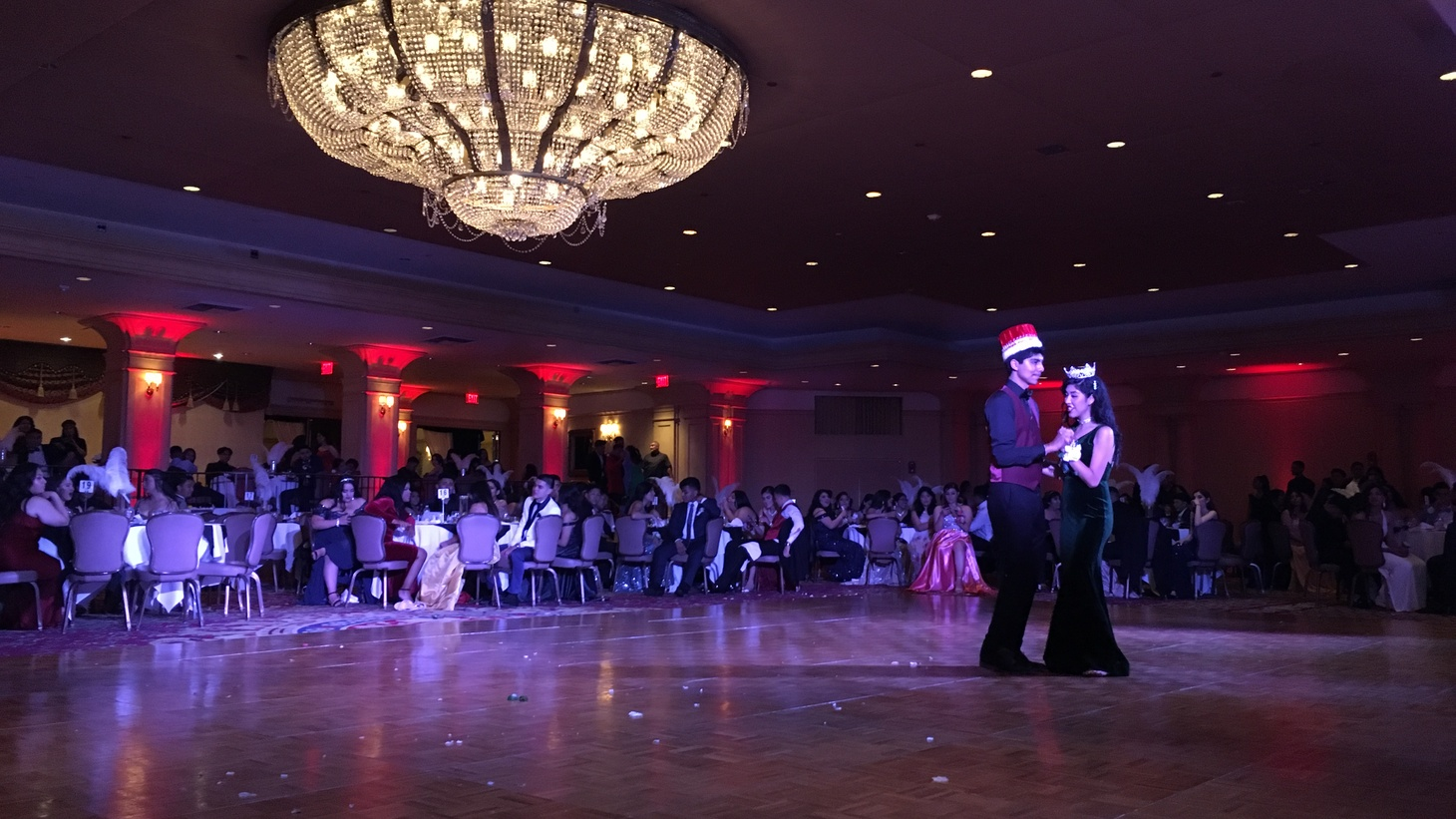 The Roosevelt High School prom king and queen dance at prom.