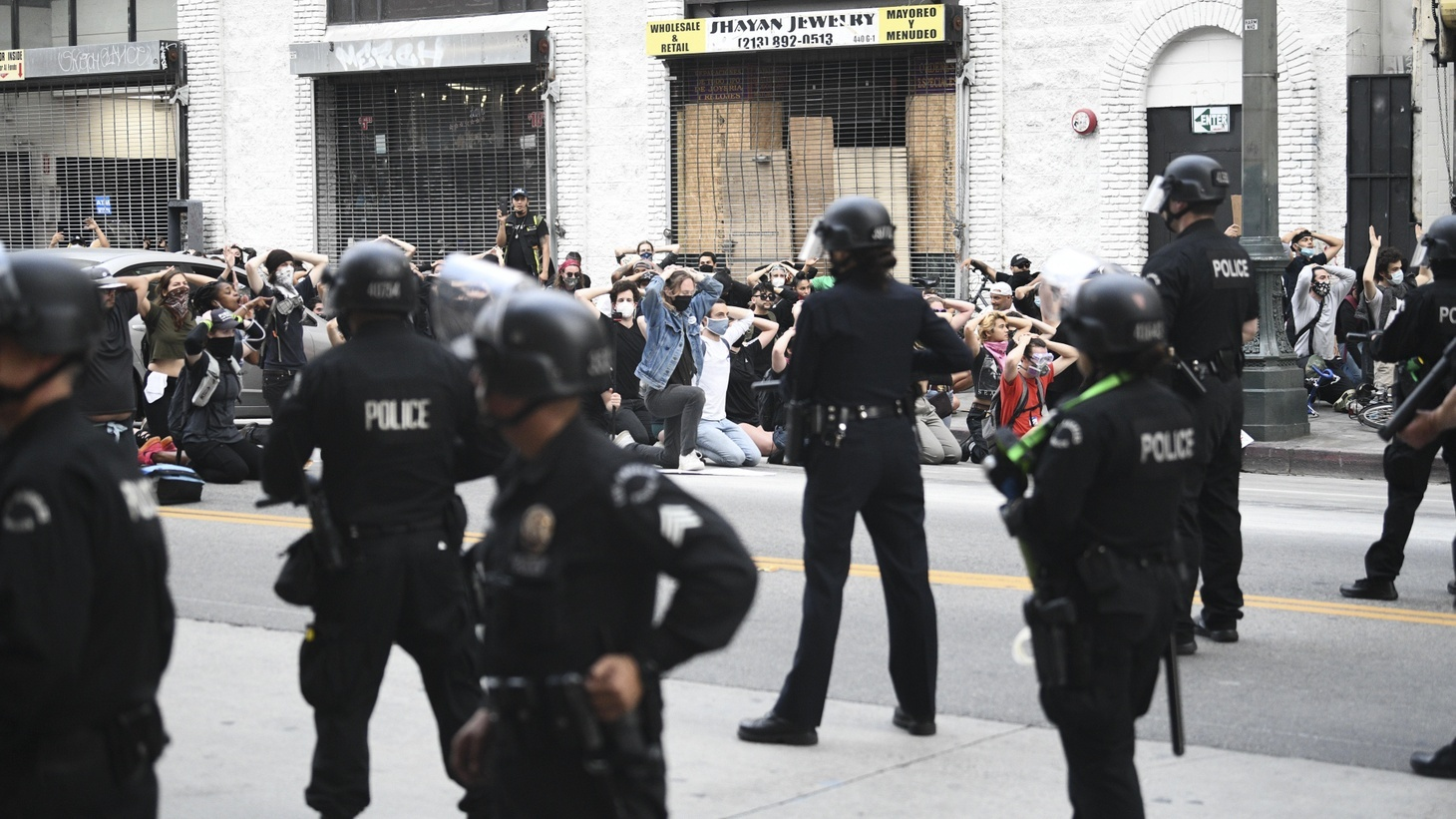 Hundreds of people prepare to get arrested for violating curfew while protesting the death of George Floyd in downtown Los Angeles, Calif. on June 2, 2020.