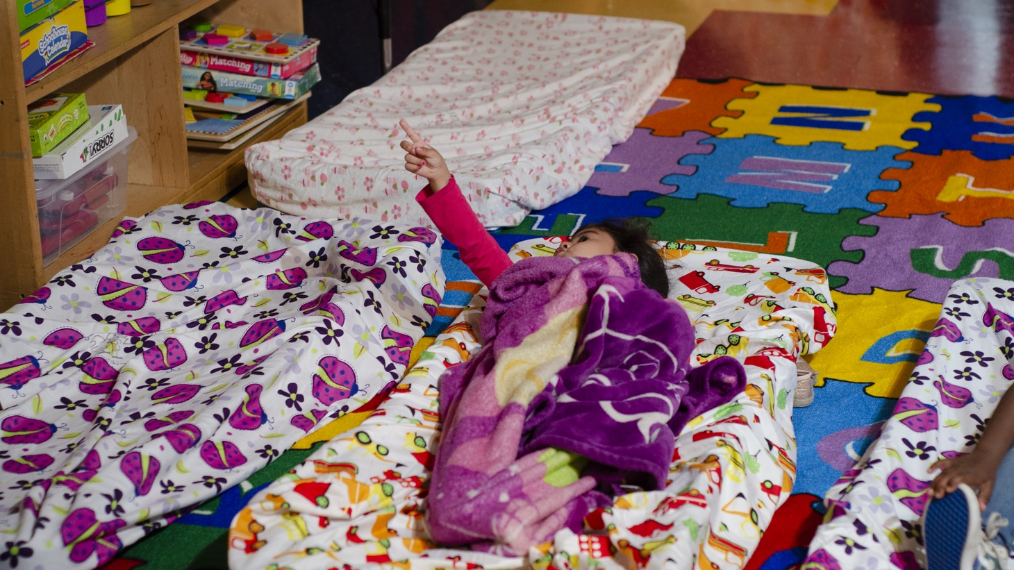A baby lies down at the 24-hour childcare.
