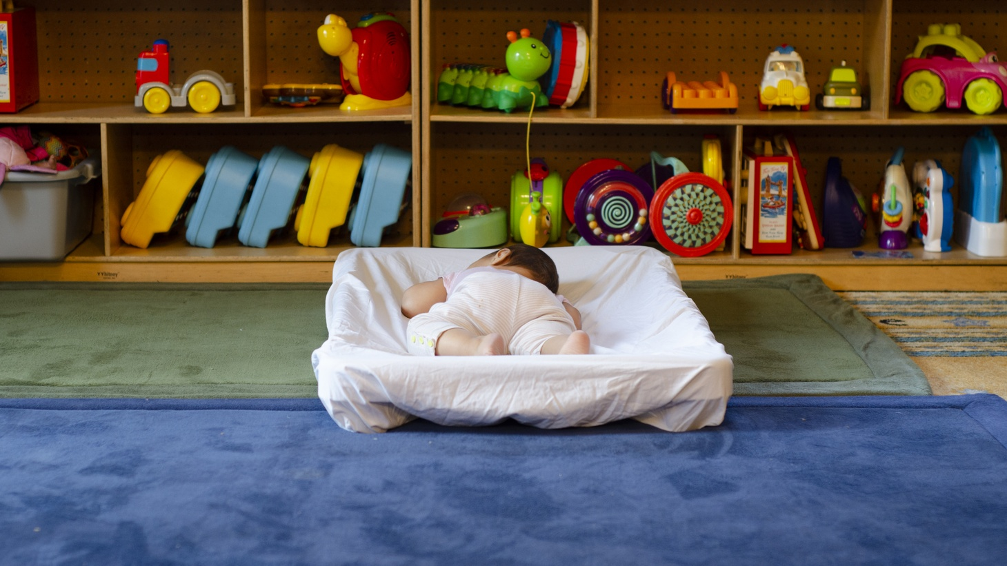 A baby sleeps in the baby room which is designated for newborns to two-year-olds.