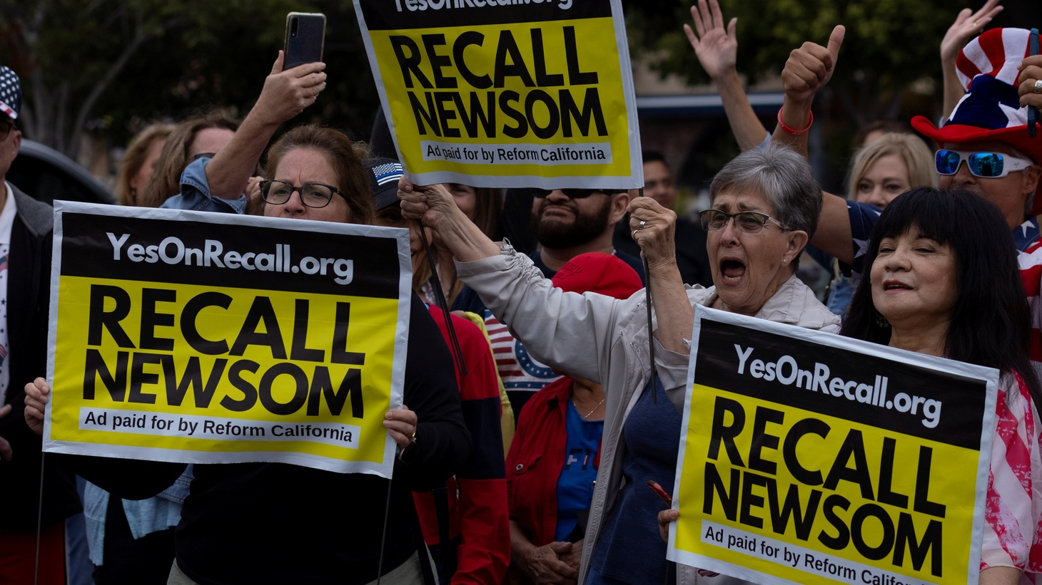 Supporters of the recall campaign of California governor Gavin Newsom prepare for the upcoming recall election with a rally and information session in Carlsbad, California, U.S., June 30, 2021.