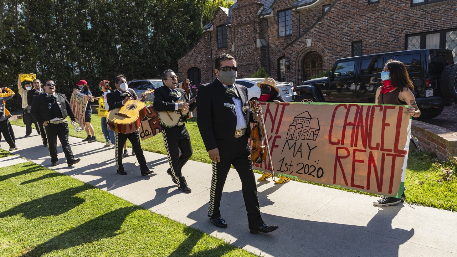 A tenants' rights group marches to the Los Angeles Mayor's mansion to demonstrate for renters' rights. Many LA residents have lost work due to the COVID-19 pandemic, and they have to choose between buying food or paying rent. 5/1/2020 Los Angeles, CA.