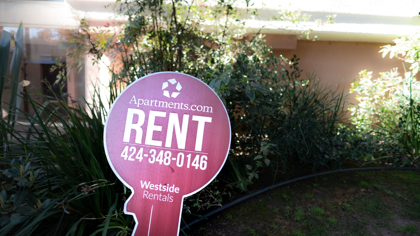 A rental sign is seen in front of an apartment building along Cardiff Ave. in the Palms neighborhood of Los Angeles. This week, LA leaders announced a new plan to eliminate all rental debt accumulated by low-income households due to COVID-19.