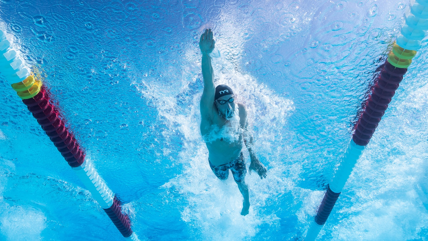 """Jordan Wilimovsky is competing in the 10,000 meter open water race in the Summer Olympics. He's been training in a pool, and navigating pandemic-forced pool closures have been tough. """"I've been driving all over the place, going out to Burbank to train there, or commuting back and forth to Mission Viejo to train. … Just recently I have been able to find consistent training in Los Angeles,"""" he says."""