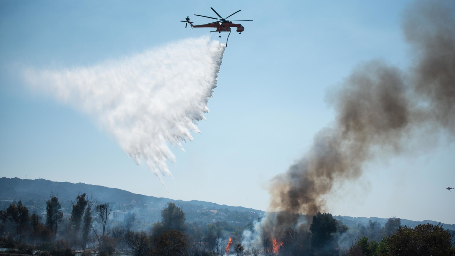 More than 100 firefighters battle the intensely hot weather to extinguish the fire in the Sepulveda Basin in California, United States on September 7, 2020. With the help of Los Angeles County manual crews, LAFD CERT volunteers and an overhead crane, firefighters declared 100% containment after more than three hours of work by land and air, protecting the Japanese gardens and the water reclamation plant. The cause of the fire is still under investigation.