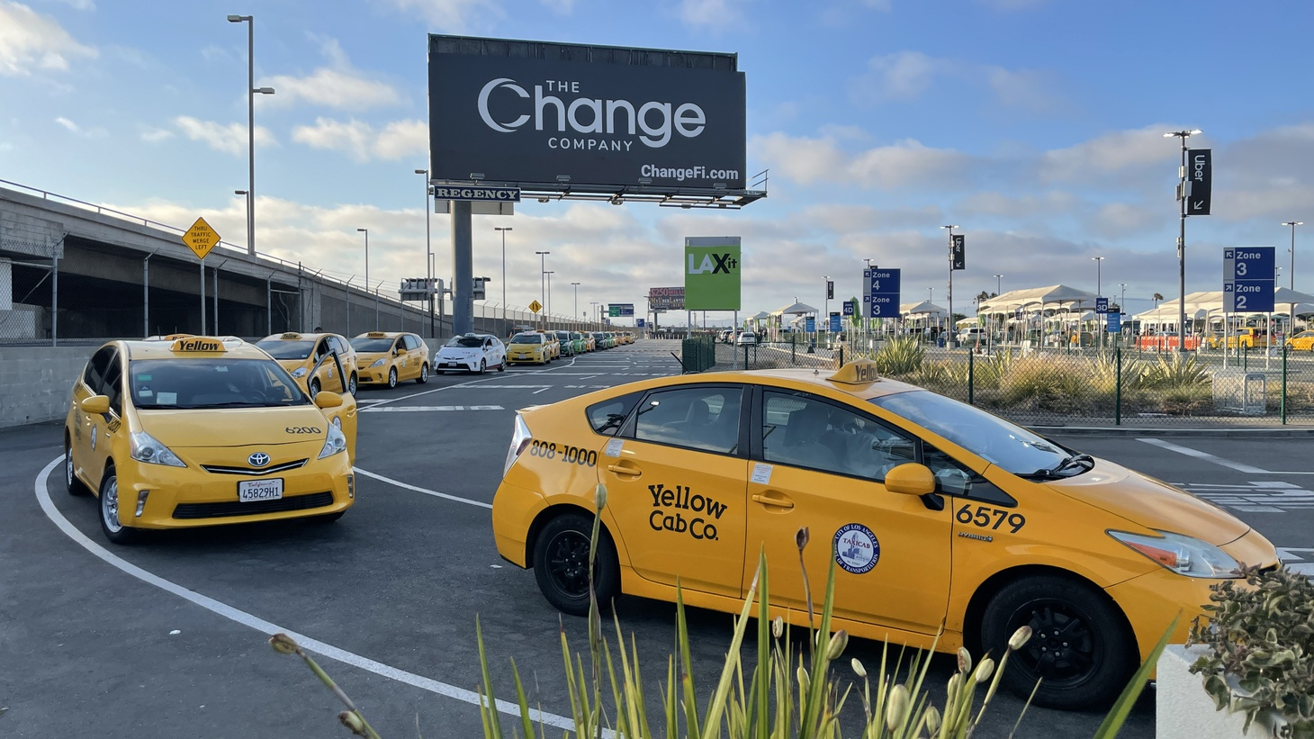 A line of some two dozen taxi cabs wait for passengers at the LAX-it lot at LAX.
