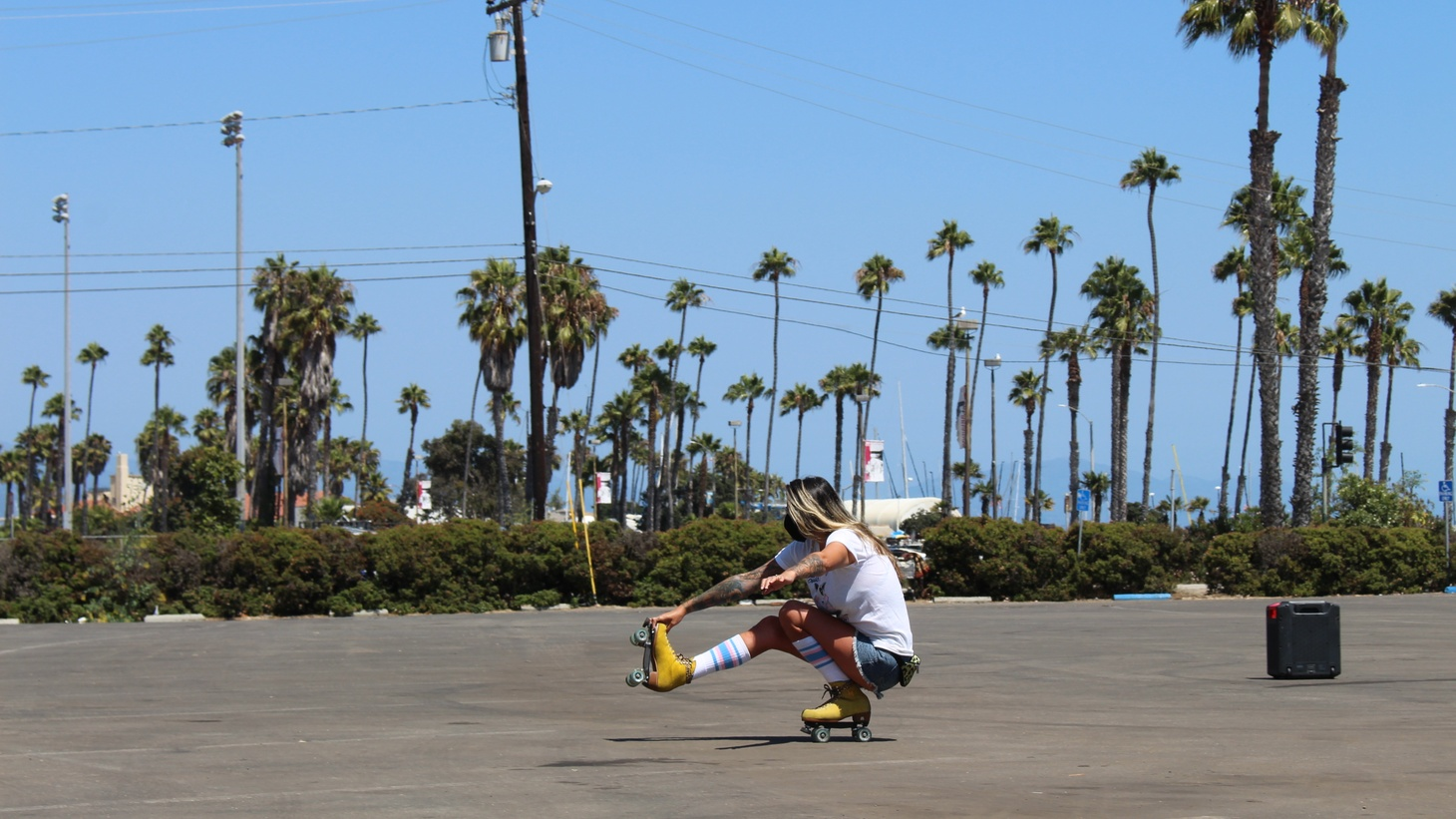 A skater works on her move at a roller skating meetup in Santa Barbara.