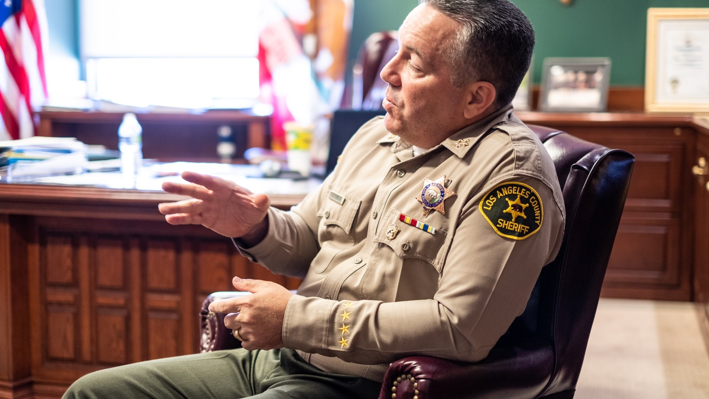 LA County Sheriff Alex Villanueva in his office with KCRW's Warren Olney.