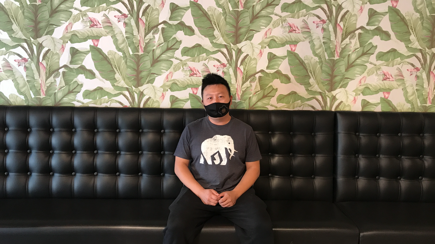 Jason Tsai, owner of Popping Yoke, sits inside his empty dining hall on Main Street in Alhambra. The restaurant has been holding on during the pandemic despite a reduction in profits, but the suspension of indoor dining could be devastating.