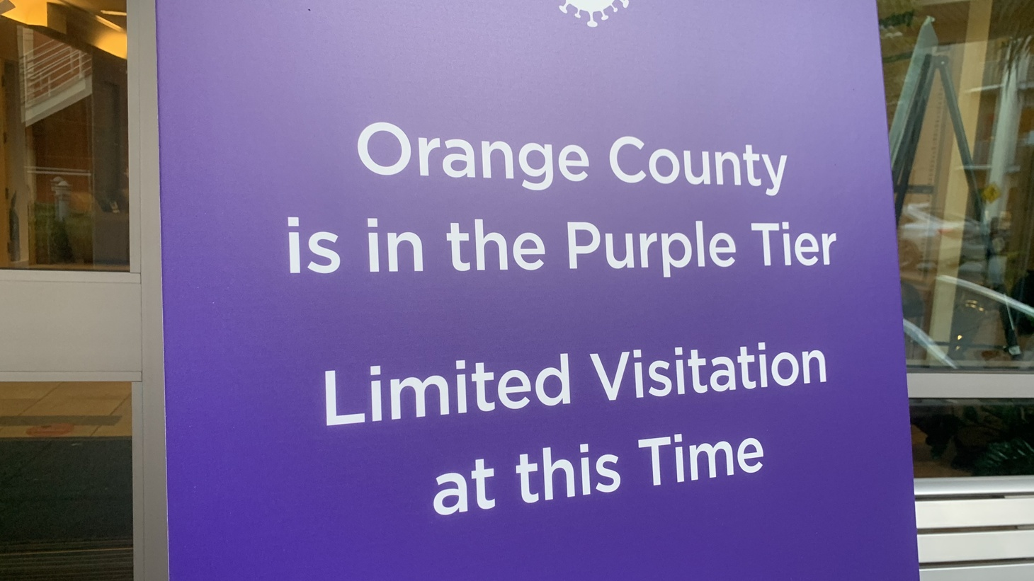 A sign at St. Jude Hospital in Fullerton says Orange County is in the purple tier of Gov. Gavin Newsom's reopening plan, and visits are currently limited. November 30, 2020.