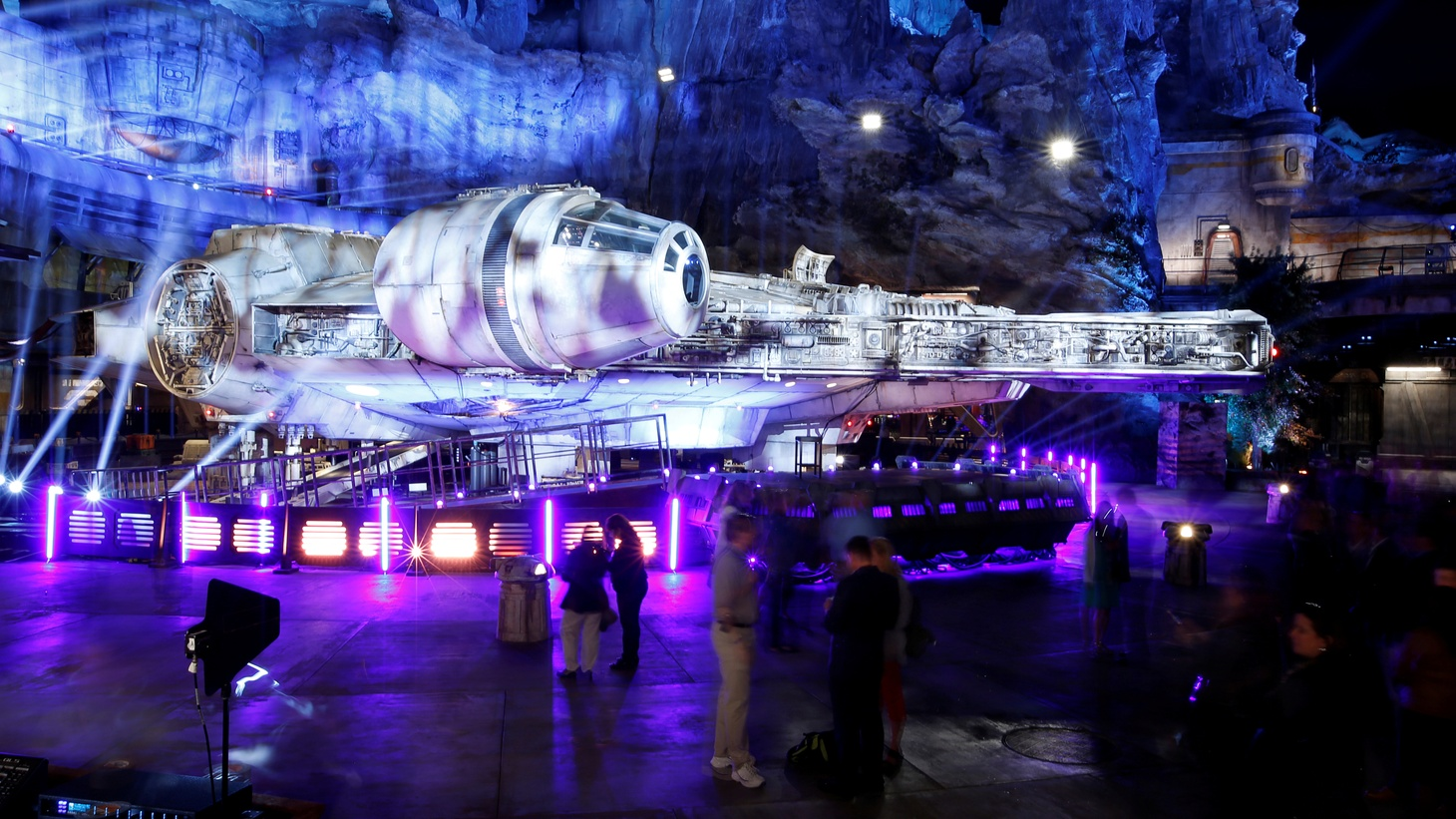 "Guests explore ""Star Wars: Galaxy's Edge"" near a Millennium Falcon starship at Disneyland Park in Anaheim, California, May 29, 2019."